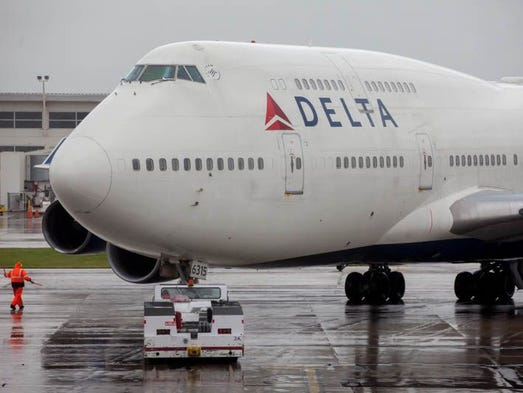 A Delta Air Lines Boeing 747-400 is pushed back for