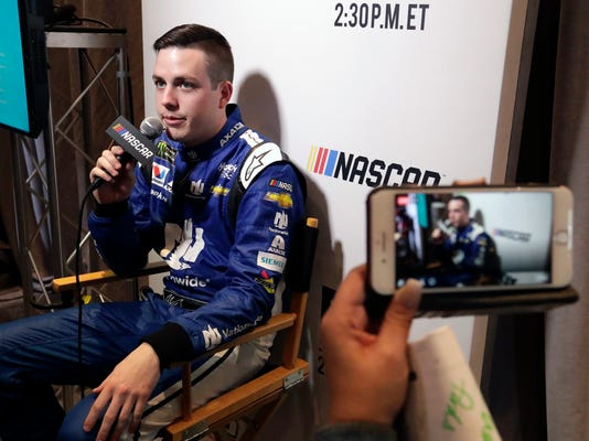Daytona 500 pole sitter Alex Bowman answers questions during an interview at during media day for the NASCAR Daytona 500 auto race at Daytona International Speedway, Wednesday, Feb. 14, 2018, in Daytona Beach, Fla. (AP Photo/John Raoux)