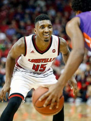 Louisville's Donovan Mitchell is all smiles on defense. 