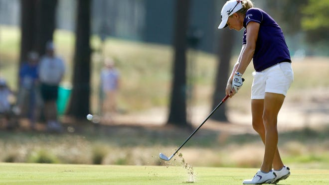 Stacy Lewis hits her approach shot on the 13th fairway during the first round of the U.S. Women's Open in Pinehurst, N.C., on Thursday.