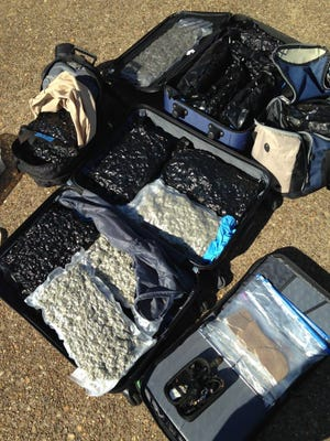 Troopers found more than 34 pounds of high-grade marijuana valued at more than $150,000 and more thn 550 grams of hashish valued at more than $8,500.