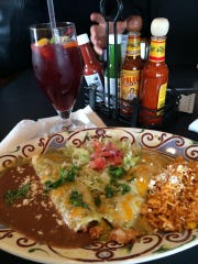 A chicken enchilada platter and red sangria at Spicy