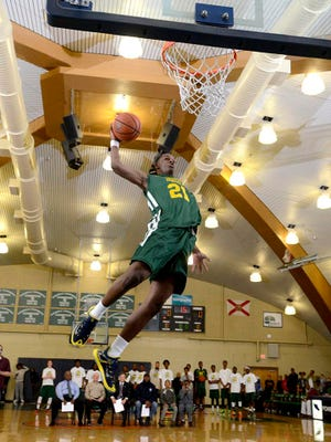 Teandre Jones launches from the free throw line during Friday night's dunk contest.