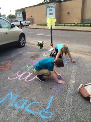 Students at Hobbs Middle School honored their coach, the late Mike McMillion, by decorating his parking space on Thursday.