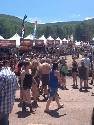 Spectators attend the Taste of Country festival at Hunter Mountain