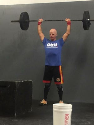 Retired Mansfield police John Fuller works out five days a week.