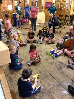 Children and caregivers listen to a story at a recent Birth-to-Five Book Buddies event at Hayes Arboretum.