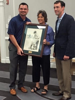 """JCJC Athletic Director Katie Herrington is presented with the Dave """"Boo"""" Ferriss Influence Award by state Fellowship of Christian Athletes Director Josh Gilreath, left. The award was presented during the FCA Coaches Luncheon at the Mississippi Association of Coaches All-Sports Clinic at the Jackson Hilton on July 16. Dr. Chad Hosemann, right, is with Capital Orthopaedic and Sports Medicine Center in Jackson, which sponsored the luncheon."""