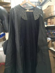 This cape is part of a suit Michael Keaton wore for his role in Batman. Part of the proceeds from the sale of the suit were donated to the Marion-Polk Food Share.