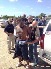 Police arrest Grover Cannon after a multi-agency manhunt. Cannon, 27 at the time, is accused of killing Shreveport police officer Thomas LaValley.