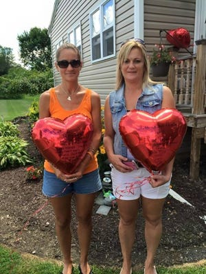 Jeanette George, left, and Lynette Bristol, display the balloons they released in memory of George's late son, Colby, on Aug. 1, 2015. George and Bristol met that day, after Bristol had found a balloon in memory of Colby in a Pennsylvania field in May.