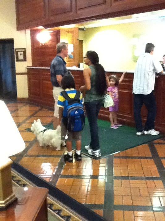This is the Gish family from Long Beach, N.Y., checking into the Holiday Inn Conference Center, one of few pet-friendly hotels in the area.