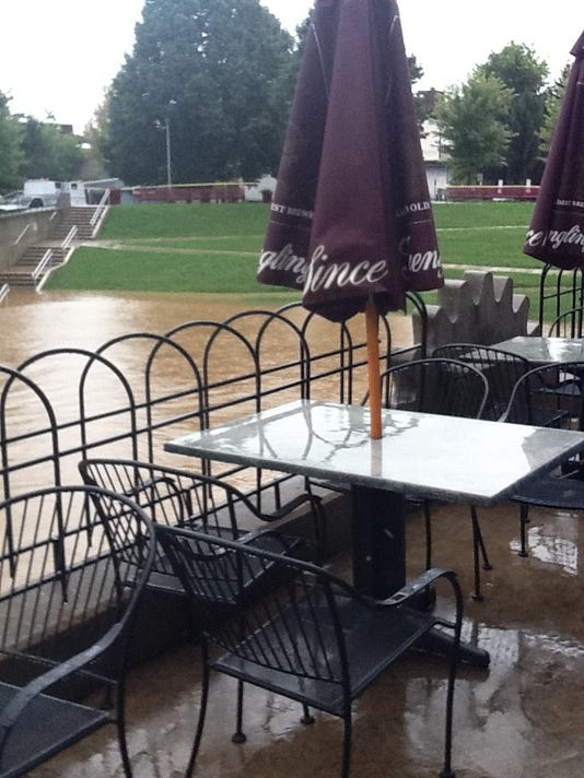 A view from the rear of the Waterway Bar & Grill's outdoor patio facing Foundry Park.