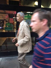 Julian Bond walks down a Philadelphia street while