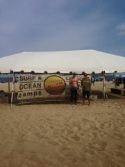 "Our instructors Mark ""Gilly"" Gilmartin (left) and Gil Olsen (right) in front of the SummerTime Surf tent on Belmar Beach"