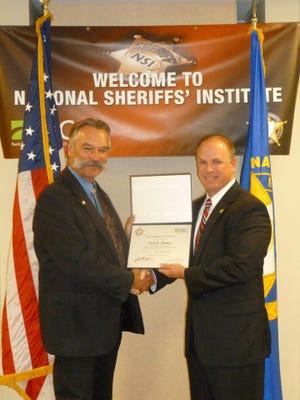 Gibson County Sheriff Paul Thomas (right).