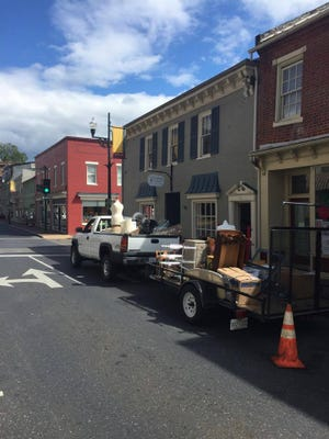 A truck and trailer moved items from the Snugbug Mercantile and Studios on Sunday, Sept. 13, 2015.