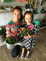 Two girls bought plants at Gramling's during March's 100th anniversary celebration. On Saturday, Grambling hosts another event to boost awareness of growing your own food.