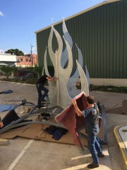 """""""The Flame"""" is a metal, 20' tall, LED lit, sculpture created by artists Bruce Allen and Jim Hayes."""
