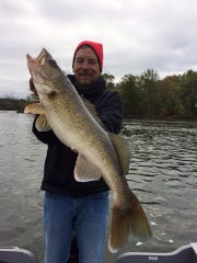 Told Holzer with a nice river walleye in central Wisconsin