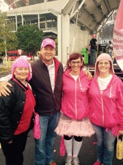 Farm Bureau's 'Farmer Charlie' likes to stop by and visit with the Chicks With Sticks team at the Making Strides Against Breast Cancer fundraiser in Nashville. From left are June Hall, Charlie, Lindsay Malcolm and Kelly Culp.