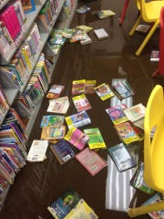 Hundreds of children's books were destroyed along with laptops and craft supplies during the flood, which reached as high as eight inches, officials said.
