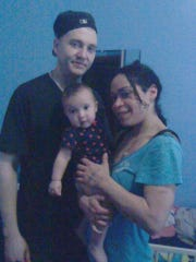 Brian Weldon and Edwina Negron with their baby, Brooklyn Molly Negron, then six months old, at their apartment in Brooklyn. Three months later, the baby's mother was charged with assault of the baby, who has been in Dutchess County foster care since.