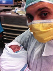 Brian Weldon, then 28, holds his daughter, Brooklyn Molly Negron, just after birth in July 2012 at a Brooklyn hospital.