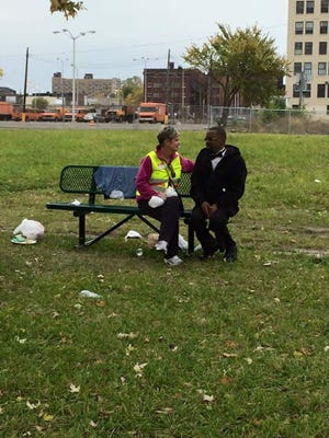 Beth Weber comforts a homeless person in Detroit.