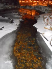 Prickly Pear Creek reflects the Christmas lights at