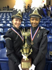 Commanders Mary Nelson and Lauren Robinson pose with the third place trophy from the Michigan Competing Band Association State Finals.