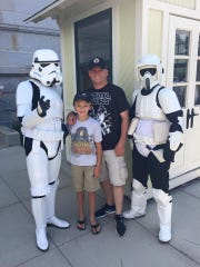 Chris Greenwell and his son Brandon with stormstroopers at Star Wars Day at Philadelphia's Please Touch Museum.