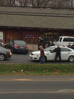 Staunton police officers stop a vehicle Tuesday afternoon with weapons drawn.