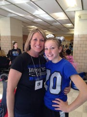 Canton Lions cheer director Rosie Beadle and daughter Alaina. Rosie is retiring from the position.