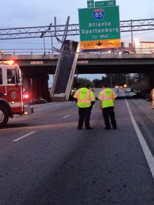 A truck traveling on 385 southbound and hit the Roper Mountain Road bridge which made the bed stand up in the roadway, according to police.