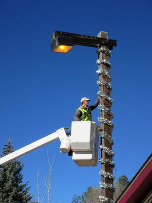 The Village of Ruidoso elves are busy adorning midtown with twinkling Christmas lights.