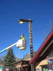 The Village of Ruidoso Parks and Recrecation Department is flying high as the crew decorates for Christmas.