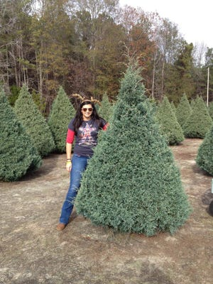 Reporter Kala Kachmar with her Christmas Tree at Wadsworth Christmas Tree Farm in Wetumpka, Alabama., on Dec. 1, 2013.