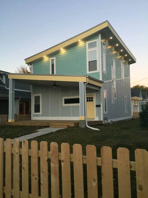 This mint green home at  1302 Linden St. is one of several colorful houses popping up in Fountain Square.