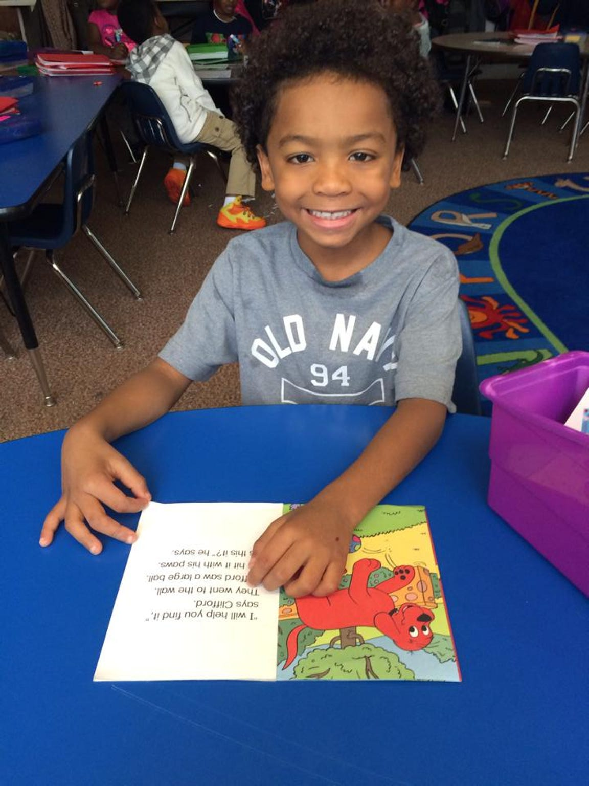 Jesiah Troutman reads a book at Urban Choice Charter