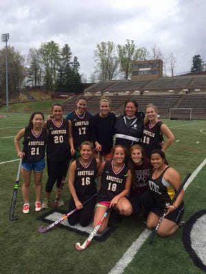 Asheville High field hockey coach Lauren Kaye poses here with some of her former players who got together for an alumni event in 2014.