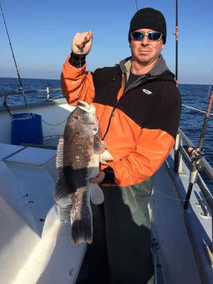 Bob Leschinski, of Manalapan, with a blackfish he caught on a party boat.