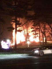 The fire at the Briarcliff Manor pool pavilion was visible from nearby streets Saturday night.