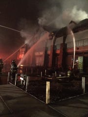 Firefighters battle a fire at the Briarcliff Manor pool pavilion in December 2015.