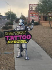 "Extreme Salon Tanning and Tattoo in north Phoenix is offering a ""Star Wars"" tattoo special. Take a look at this cool sign and costume!"