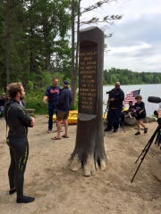 On day one of his journey down the Mississippi River, Chris Ring looks at the marker that designates the beginning of the river.