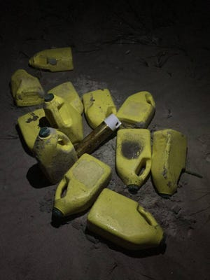 Yellow plastic jugs and a spray can were found on the beach in Cocoa Beach Tuesday.