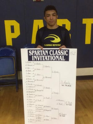 Shane Asselin poses with the complete bracket after winning the Warren Fitzgerald Spartan Classic 152 pound title.