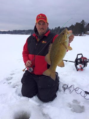 Adam Rasmussen with a nice central Wisconsin smallmouth bass.