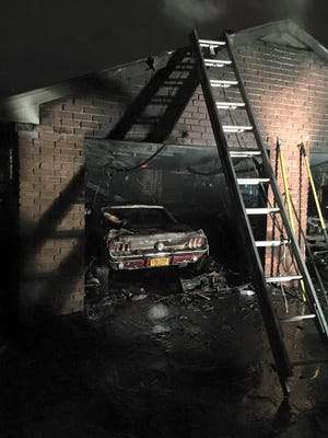 A blaze in a separate, two-car garage at a home on the 1400-block of Hudson Avenue began shortly after 5 p.m. on Saturday, Jan. 9, 2016, officials say. Two men were restoring one of two cars in the garage, which was about 25 feet from the owner's home, when the fire started.